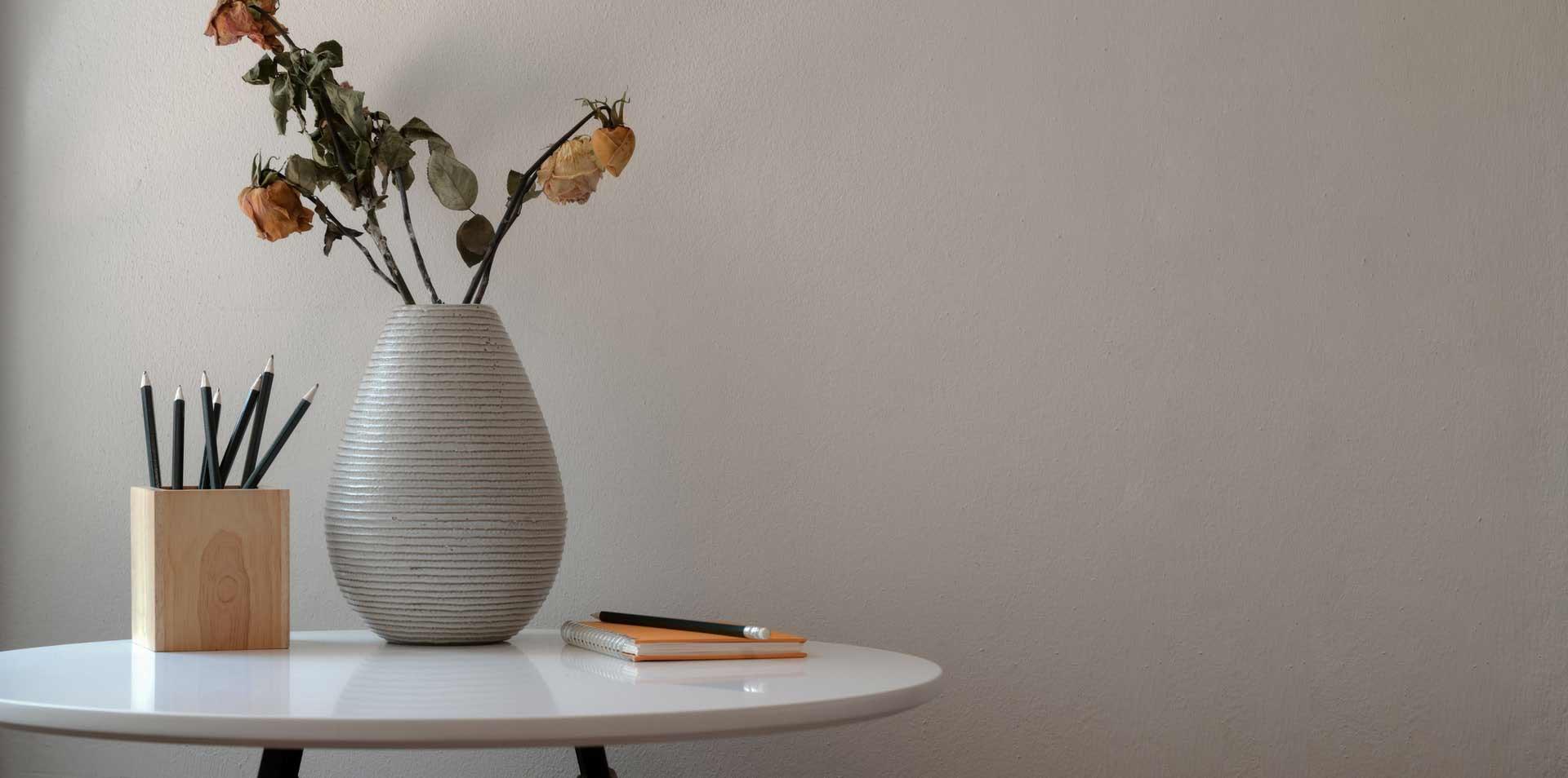 flower-vase-beside-notebook-and-pencils-3773389