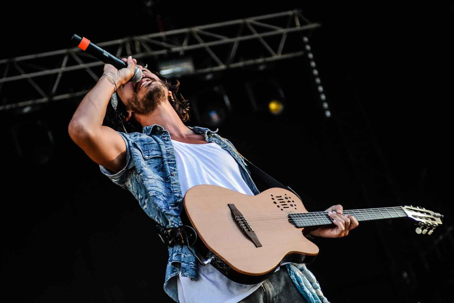 man-using-brown-and-black-electric-guitar-while-singing-167446